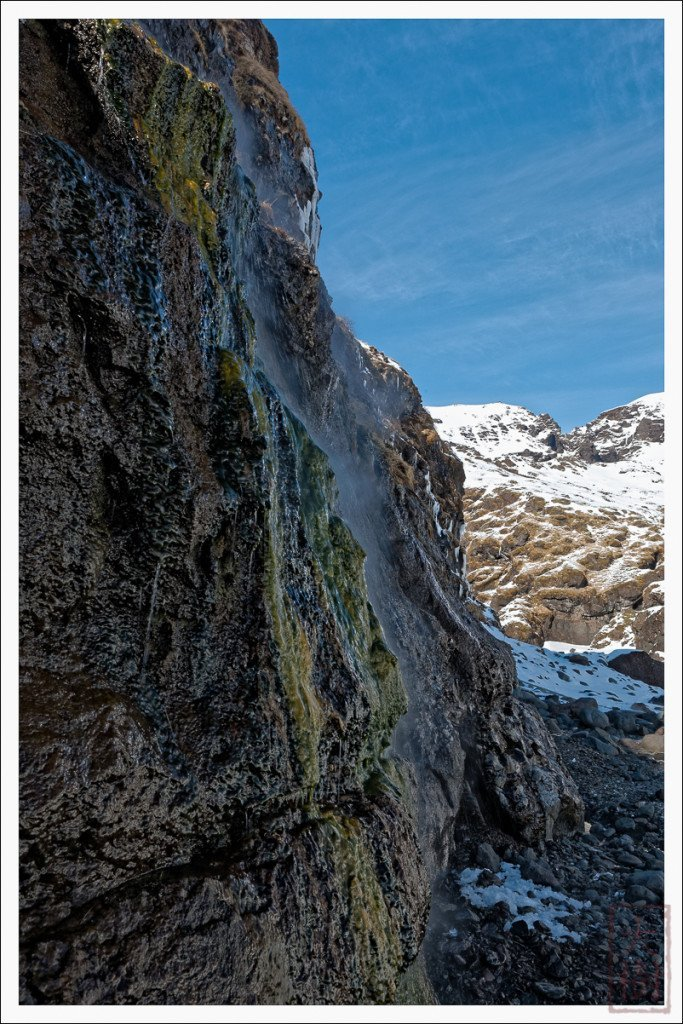 You can see steaming hot water emerging from the mountainside, and the colorful green slime that grown in the scalding hot water.