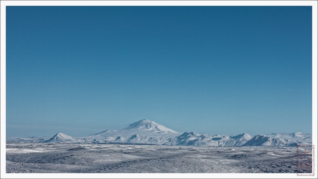 Hekla is a famous volcano in Iceland (due to erupt soon supposedly)---it the 1500 m peak in the center. Since I couldn't even hope to make it to the trailhead via car, and because I did not bring skis, it was too far given the snow to do in one day. As it was, I was post-holing through thigh high snow just to summit the hill on the left.